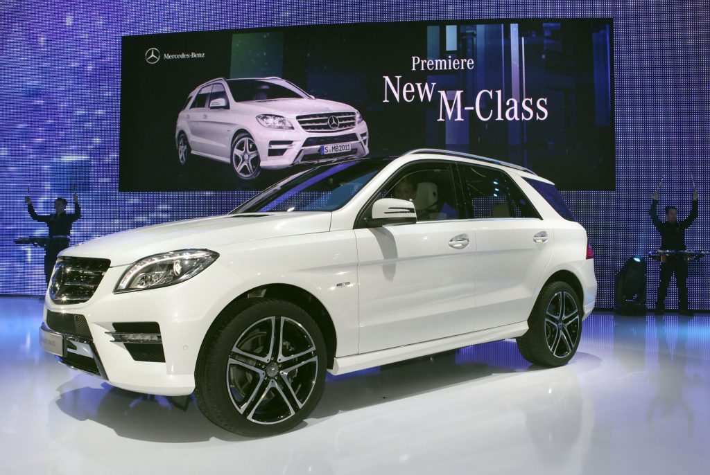 A white Mercedes M-Class SUV on display
