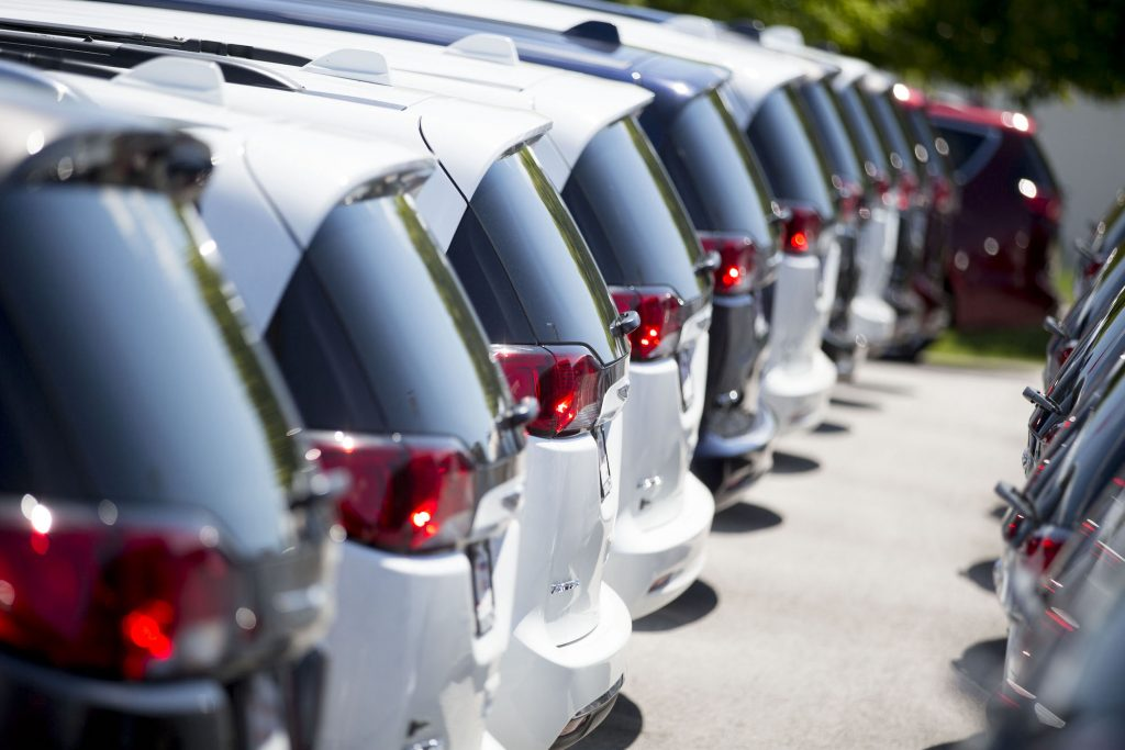 A row of 2017 Crysler Pacifica minivans displayed for sale at a car dealership in Moline, Illinois, in July 2017