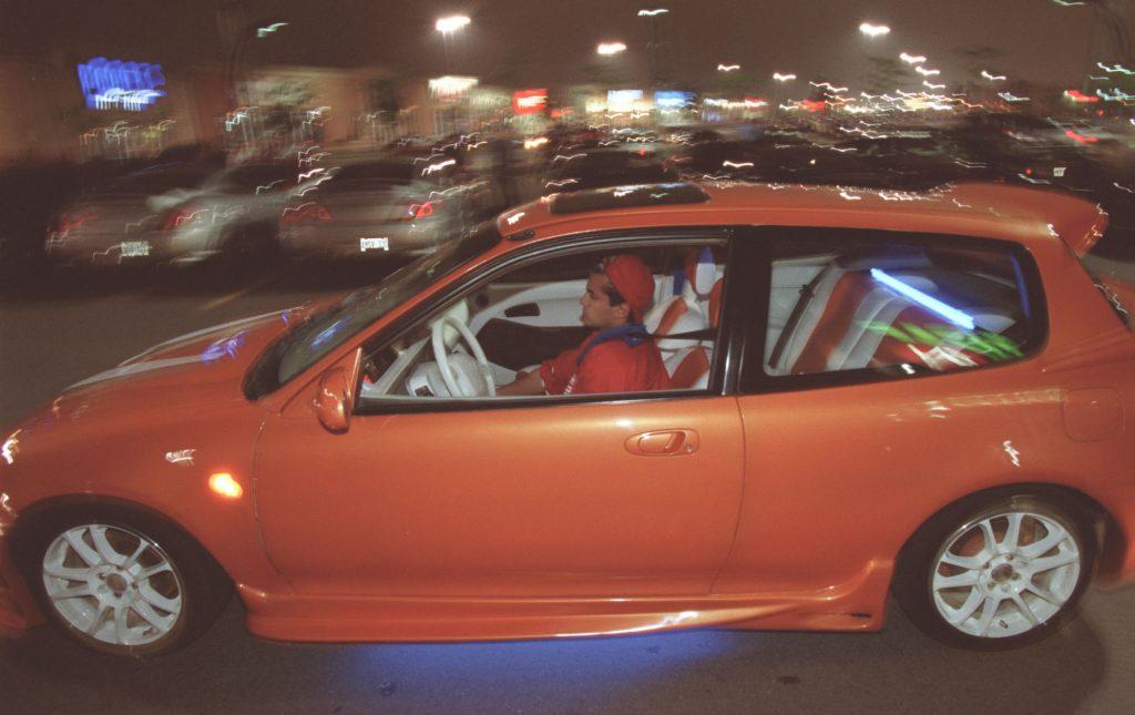 Faraz Matin drives his modified 1993 Honda Civic through a parking lot