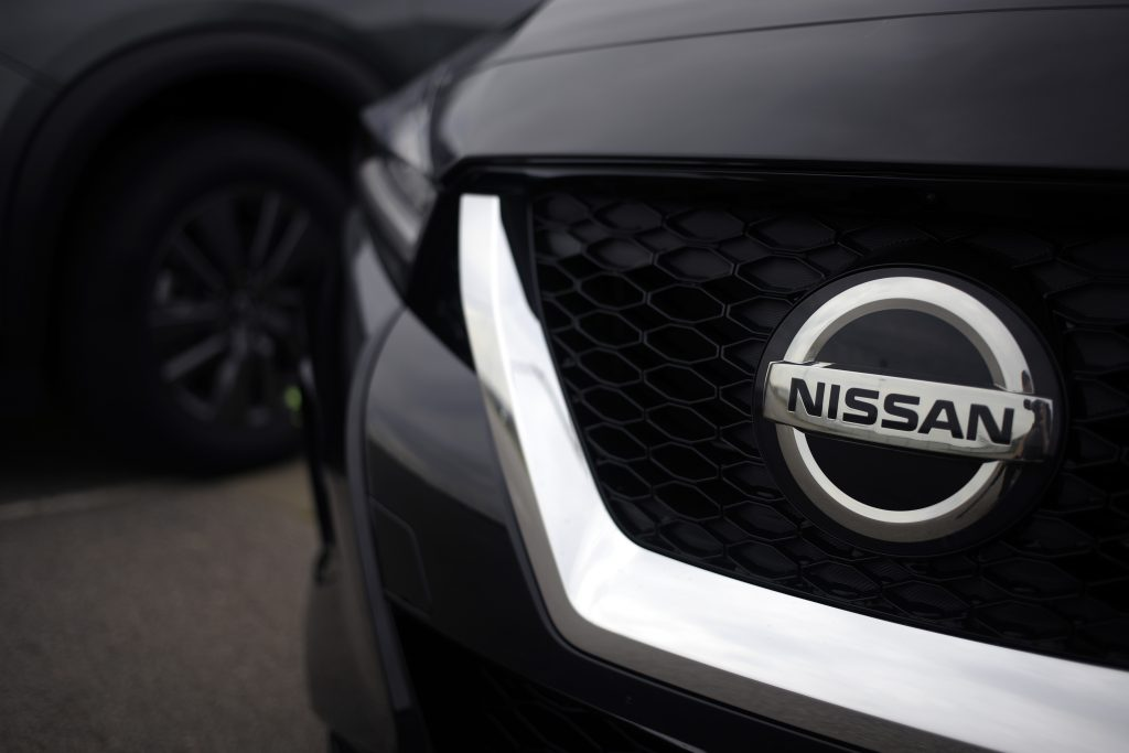 An upclose look at the modern 2021 Nissan front grille badge