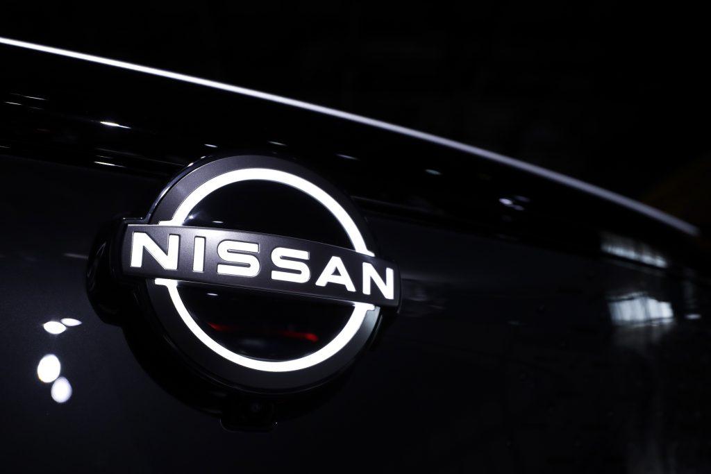 A backlit NIssan logo on a black grille