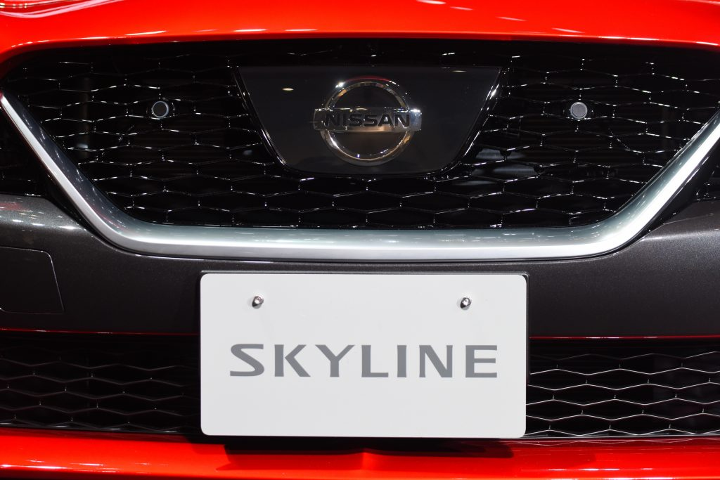 The grille of a red Nissan Skyline