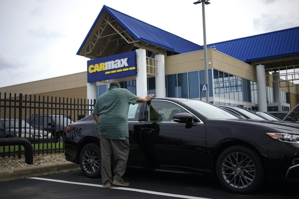 A customer shops for a used vehicle at a CarMax dealership