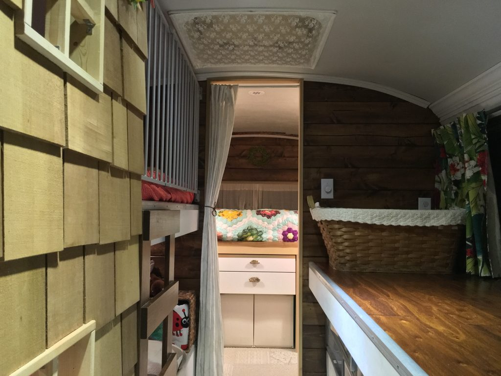 A view into the sleeping quearters of a converted school bus RV