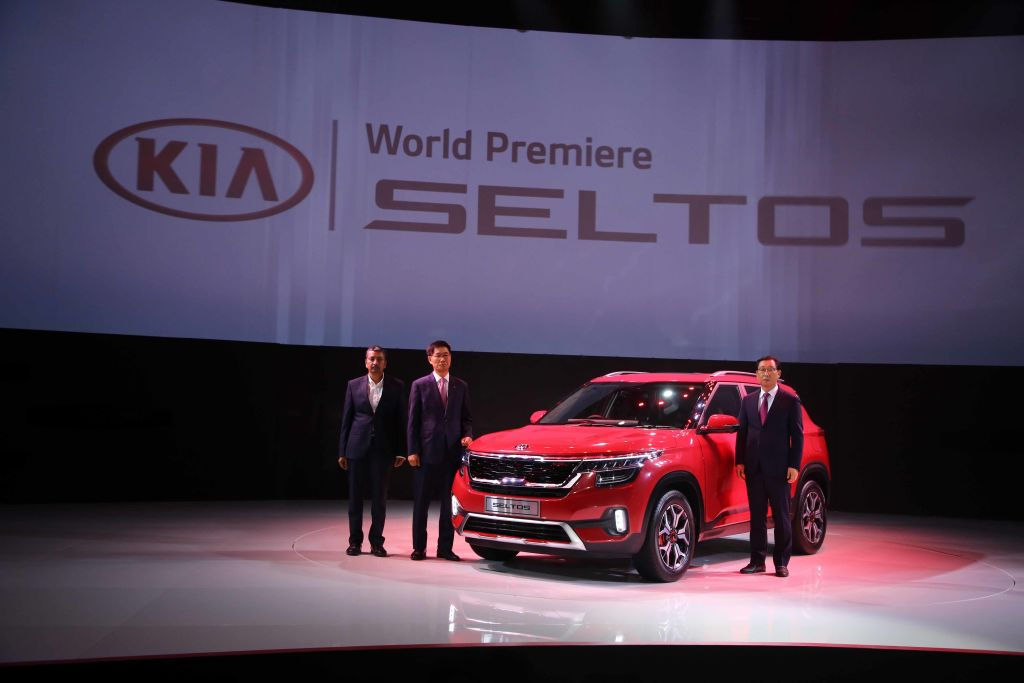 A red 2021 Kia Seltos in display