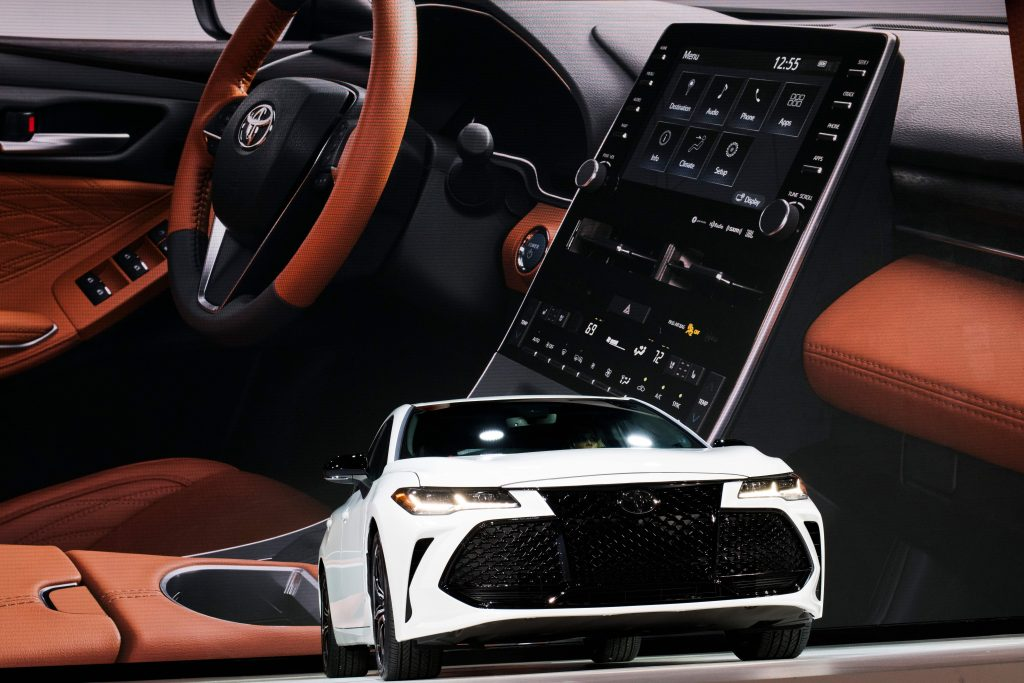 A new toyota avalon with a sneak peak of the interior