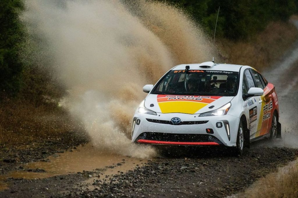 Toyota Prius Rally car ripping through a giant puddle
