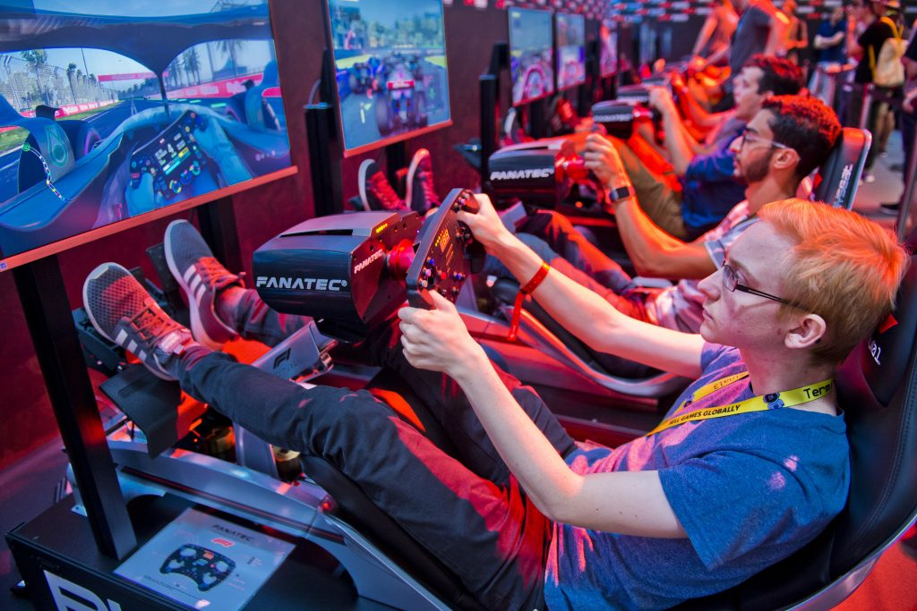 A row of video game driving simulators