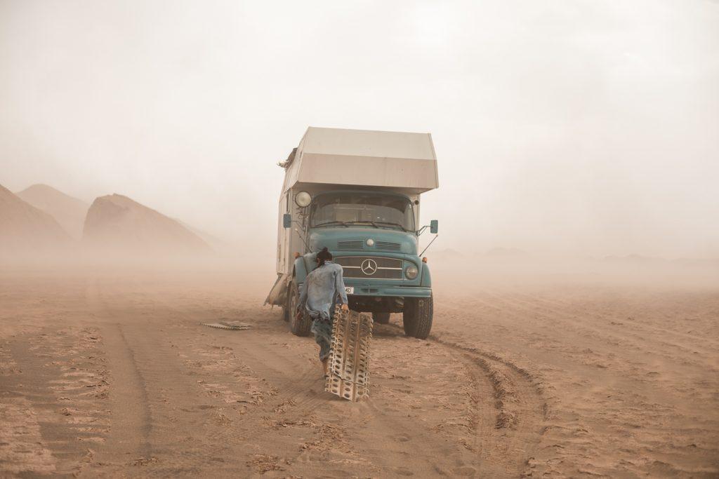 vintage overlanding camper stuck in the sand