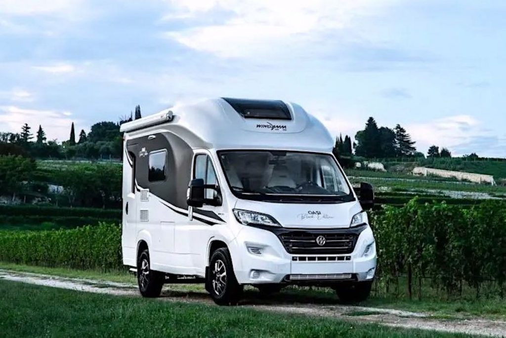 The Wingamm Oasi 540 is a tiny camper parked on a dirt road