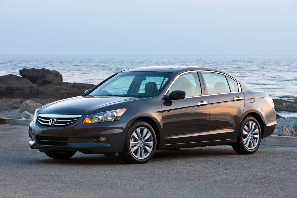 a 2011 Honda Accord parked near the shore in a press photo
