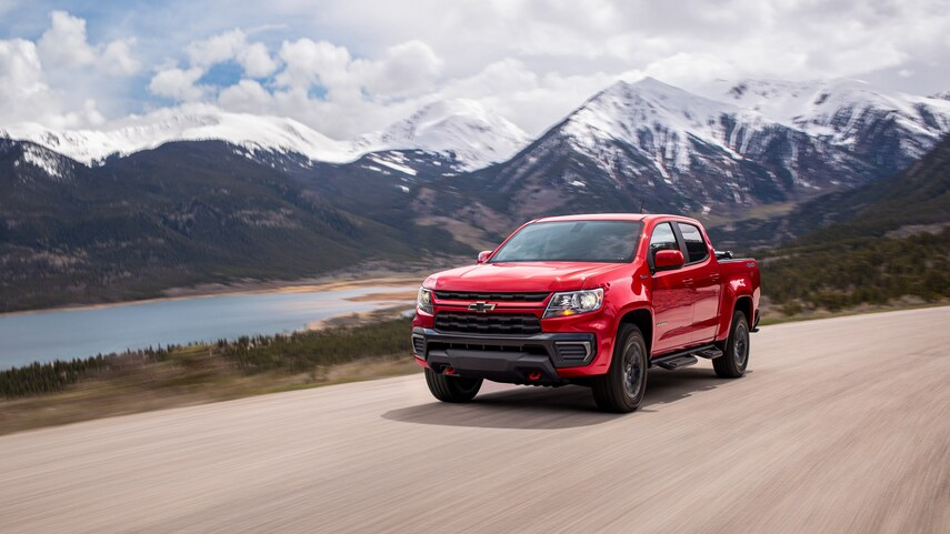 A red 2022 Chevy Colorado Trail Boss driving down the road