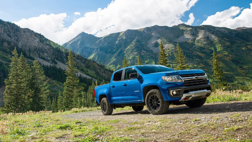 A blue 2022 Chevy Colorado Trail Boss parked on a hill
