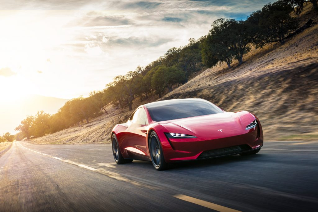 Tesla Roadster driving down the road