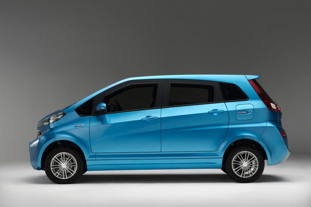 Profile shot of a bright blue Kandi K23 EV