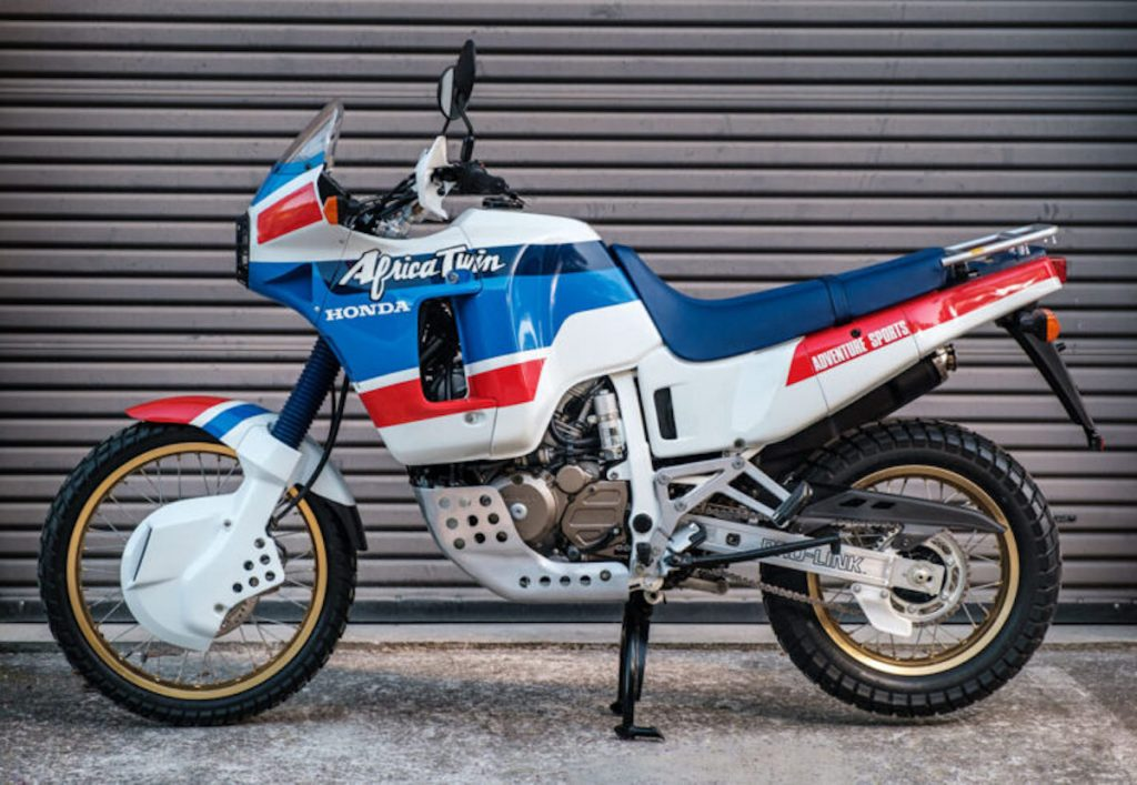 1989 vintage Honda Africa Twin parked in front of a garage
