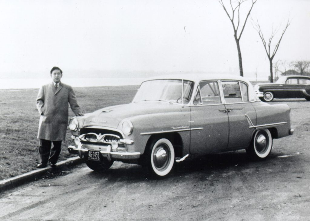 Man standing beside a Toyota Crown