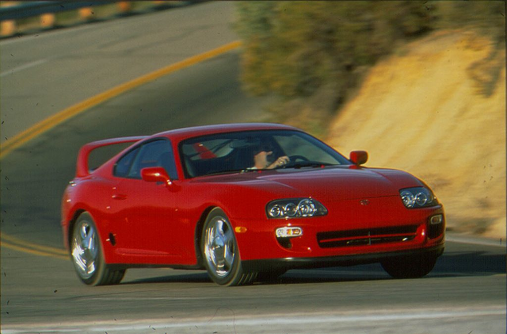 A red Supra on a canyon road in the mid-90s