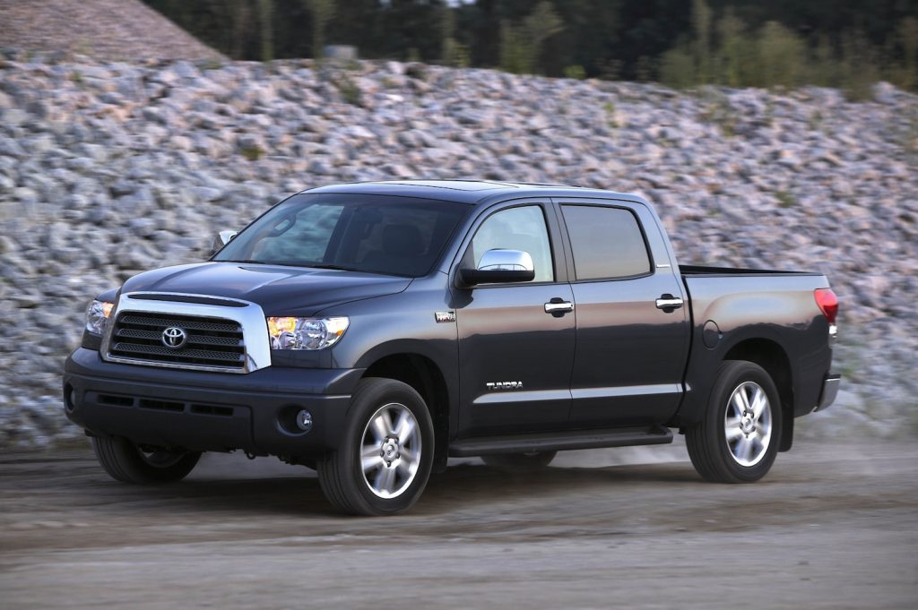 A black four-door 2005 Toyota Tundra parked next to a gravel hill, the 2005 Toyota Tundra is a used Toyota truck