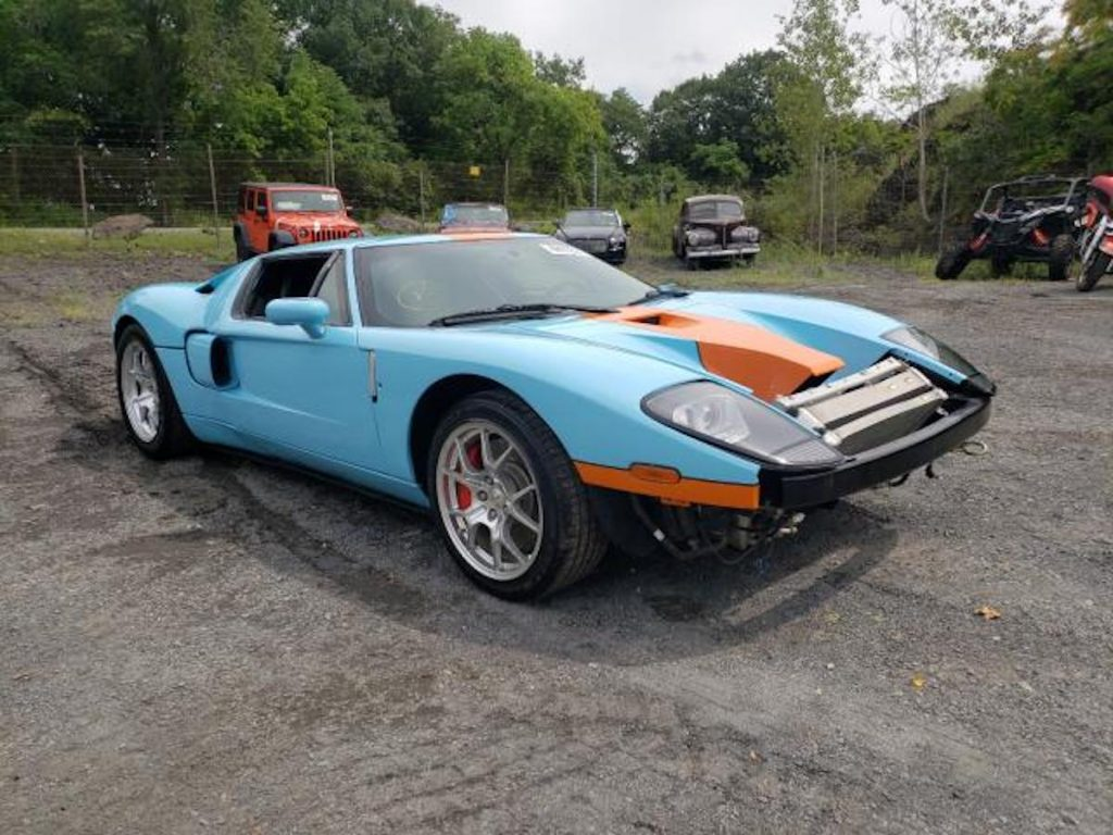 wrecked supercar 2006 Ford GT sitting in an auction lot