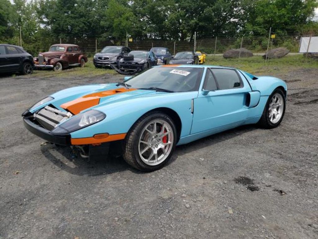 2006 Ford GT in a junk yard awaiting auction