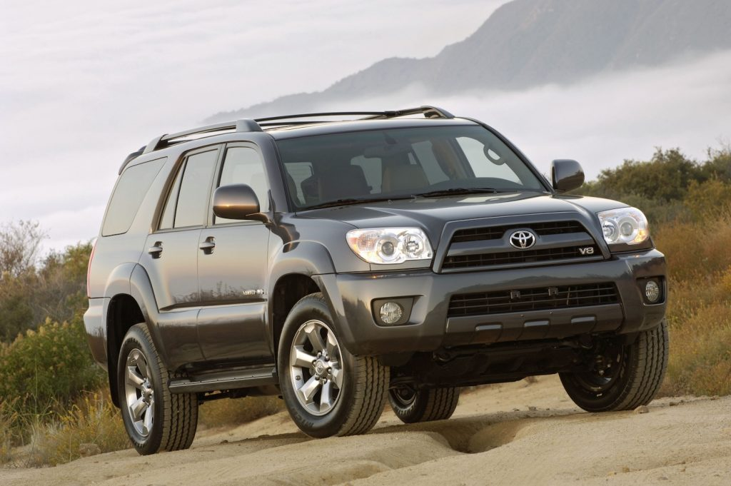A grey 2009 Toyota 4Runner on the trails, the 2009 Toyota 4Runner is one of the best used three-row SUVs under $15,000