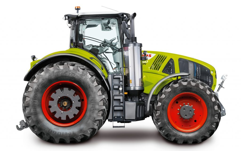 a light green Claas 960 Axiom tractor in a press photo against a white backdrop