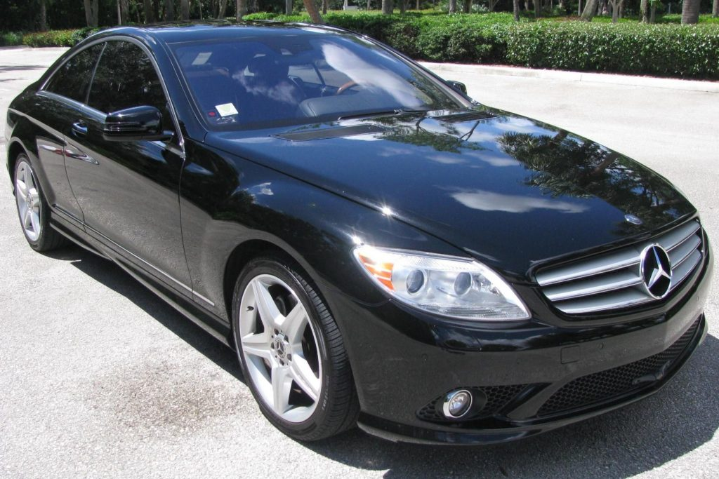 A black 2010 Mercedes-Benz CL550 4Matic in a parking lot