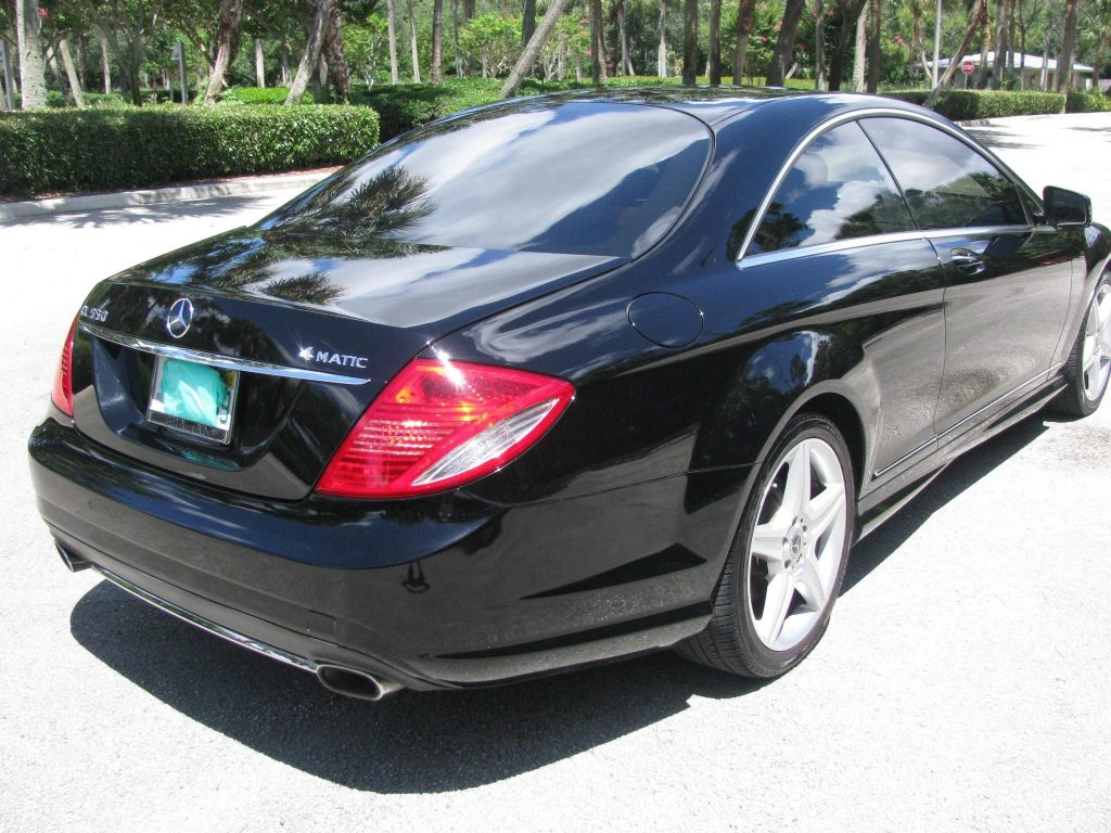 The rear 3/4 view of a black 2010 Mercedes-Benz CL550 4Matic in a parking lot