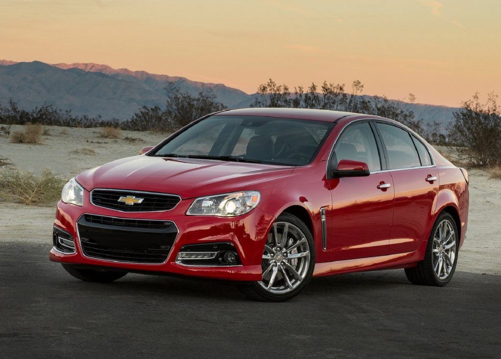 A red 2014 Chevrolet SS on a desert road