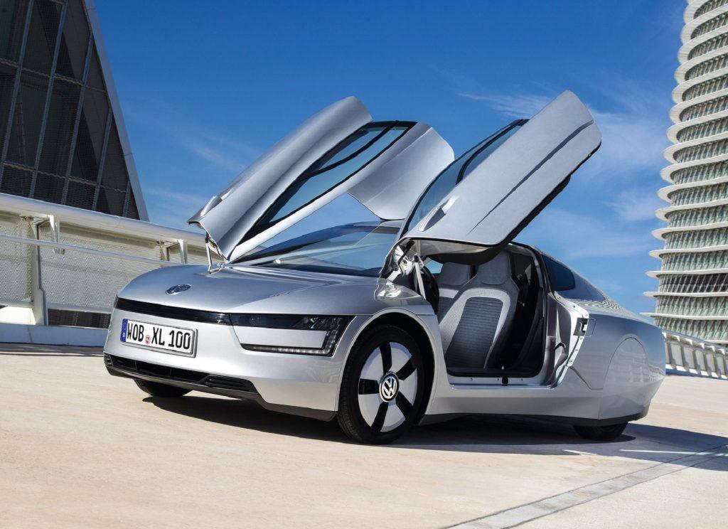 A silver 2014 Volkswagen XL1 with its doors open