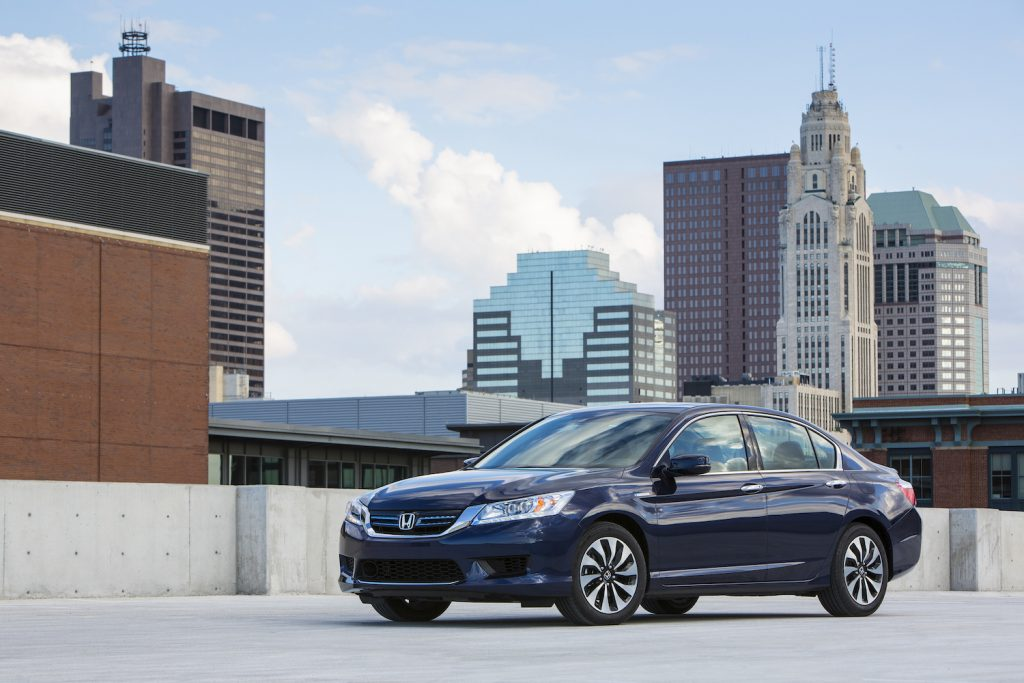 A 2015 Honda Accord Hybrid Touring parked in the city, the 2015 Honda Accord Hybrid Touring is the best used hybrid under $20,000
