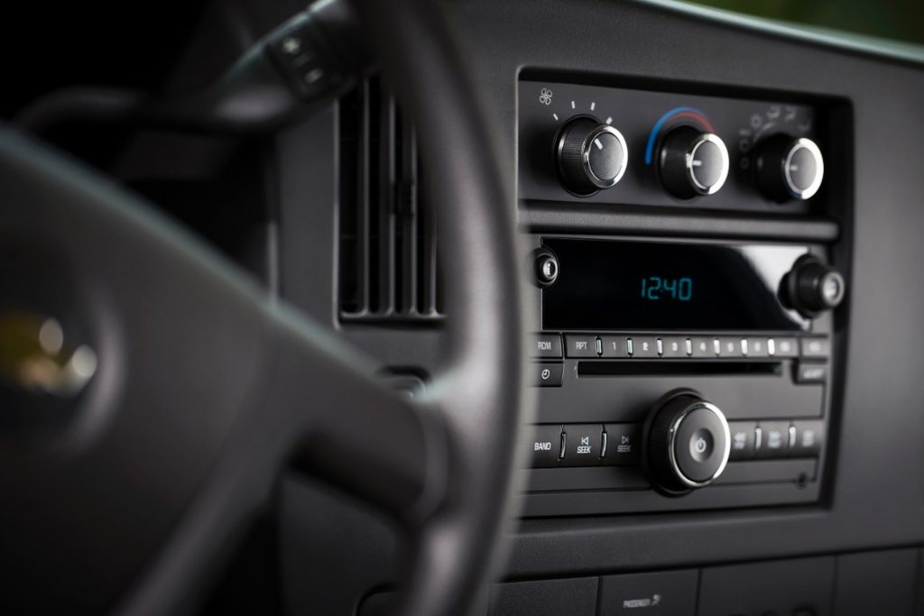 An image of a CD Player in a Chevrolet Express van, one of few models GM is killing the option for.
