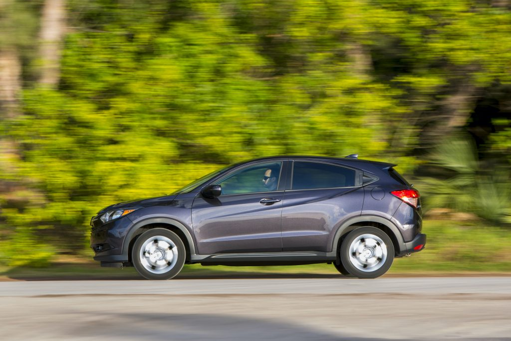 a 2017 Honda HR-V driving on a scenic wooded road