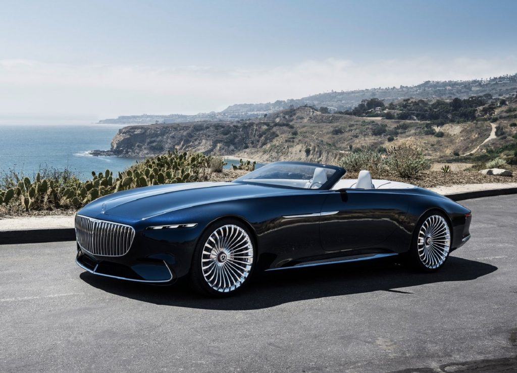 The dark-blue 2017 Vision Mercedes-Maybach 6 Cabriolet Concept on an ocean-side mountain road