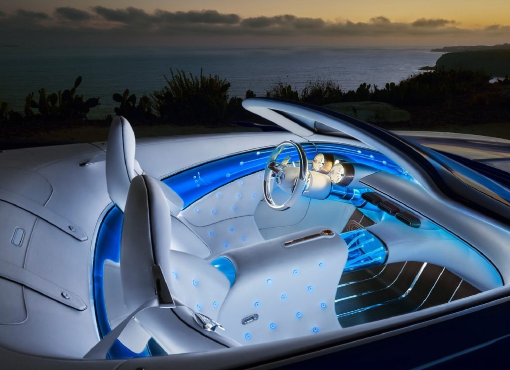 The white-and-blue interior of the 2017 Vision Mercedes-Maybach 6 Cabriolet Concept at night by the ocean