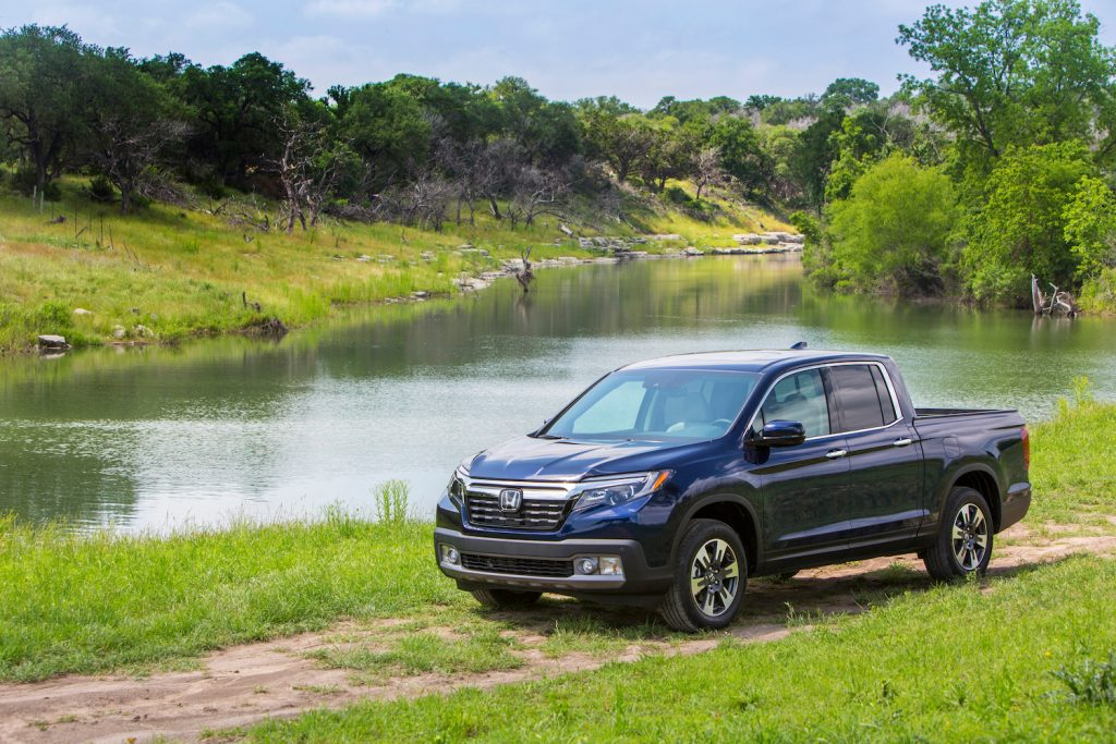 A 2018 Honda Ridgeline parked in the wilderness, the 2018 is a used Honda Ridgeline year to avoid