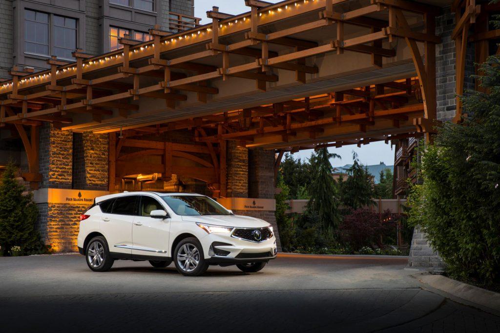 A white 2019 Acura RDX Advance SUV model parked under a bridge