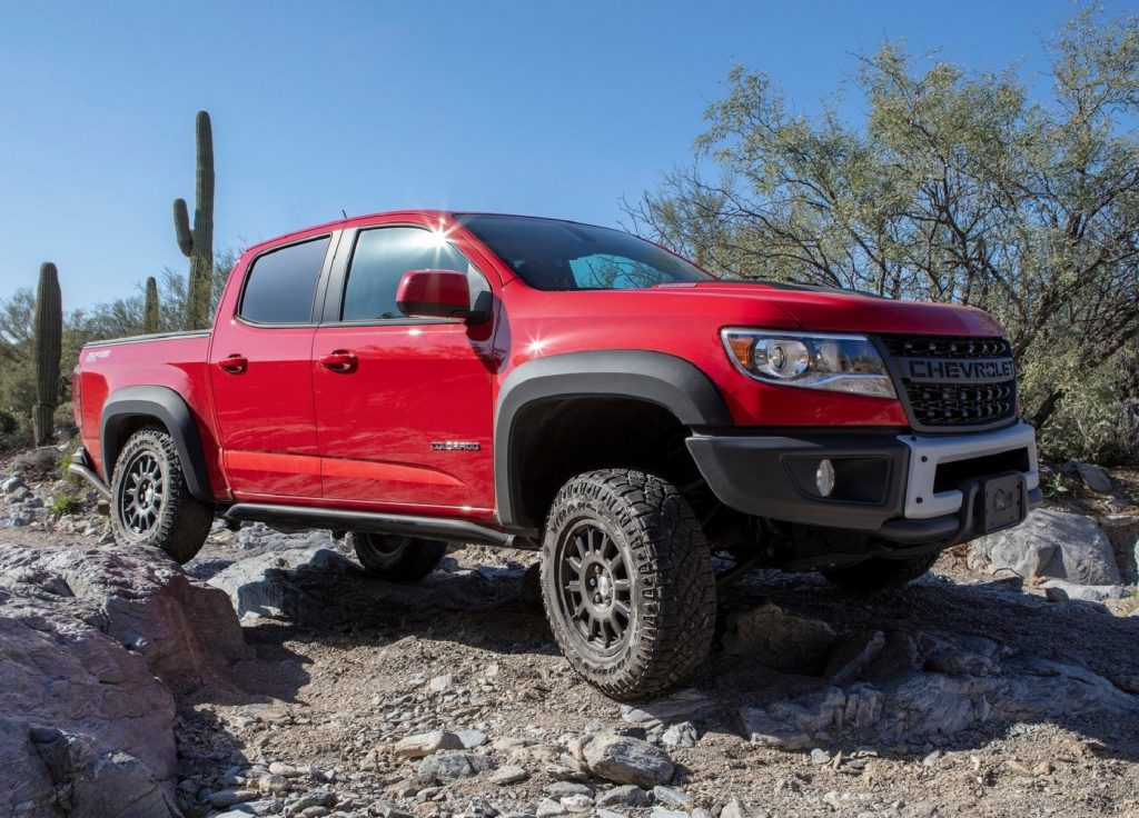A red 2019 Chevrolet Colorado ZR2 Bison rock-crawling through the desert