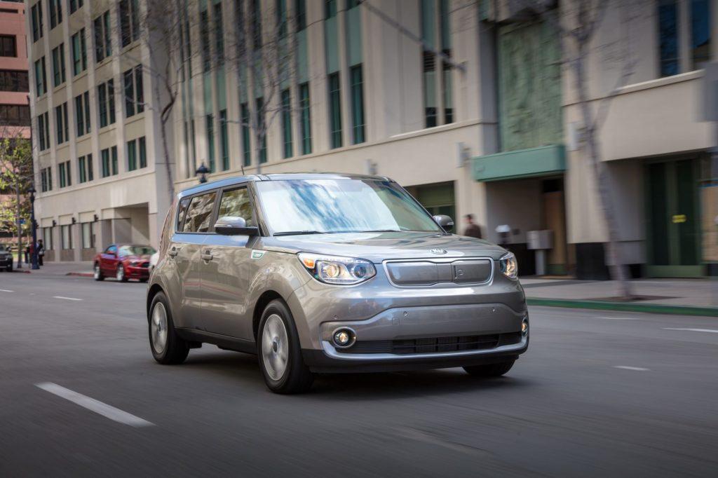 A gray 2019 Kia Soul EV model driving through a city