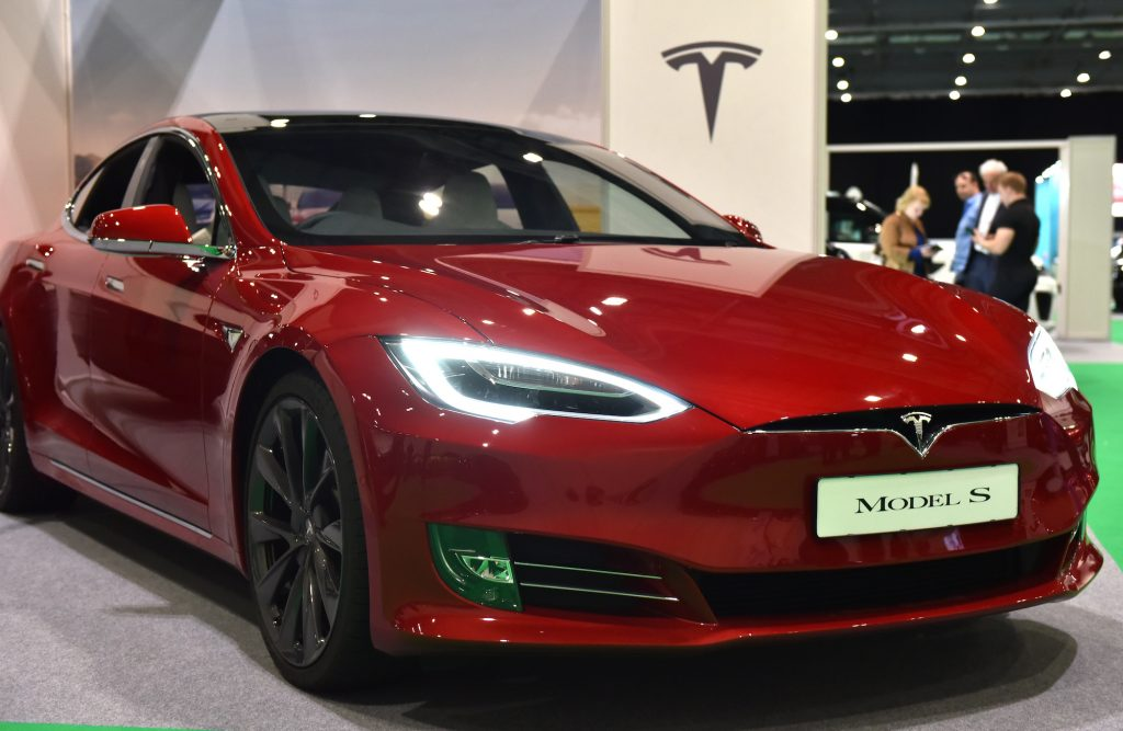 A red Tesla Model S on display at the London Motor & Tech Show at ExCel on May 16, 2019, in London, England