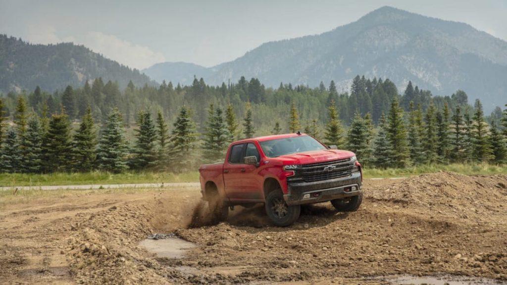 2019 Chevrolet Silverado Trail Boss running through the dirt