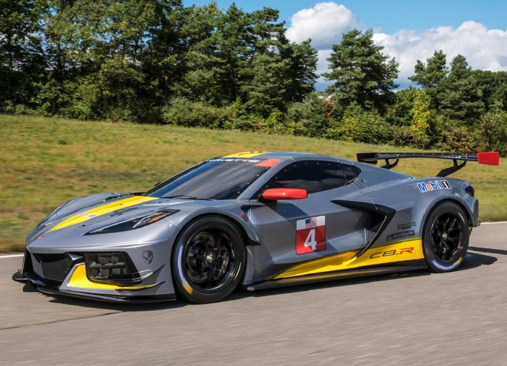 The gray-yellow-and-red 2020 Chevrolet Corvette C8.R driving around a track