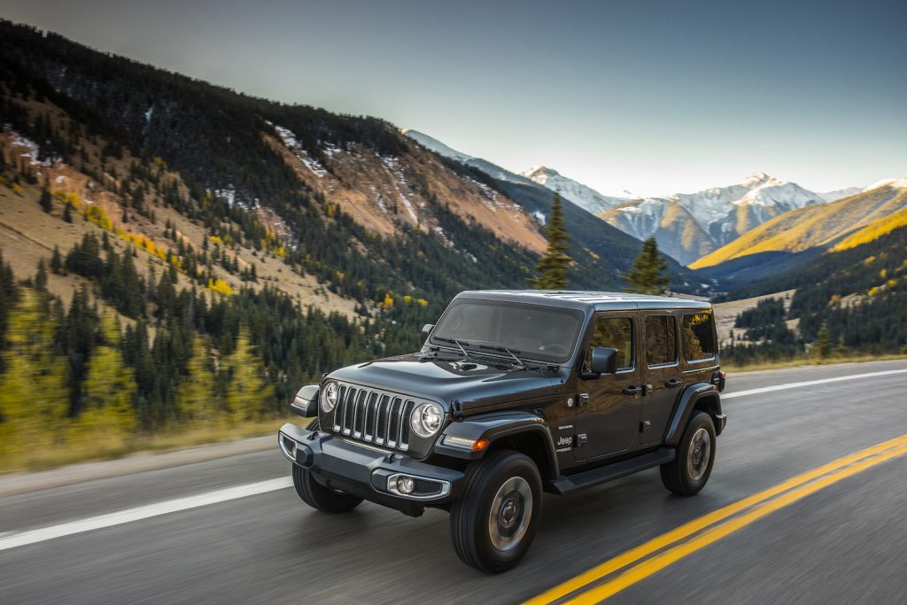 A grey 2020 Jeep® Wrangler Sahara driving, the Wrangler is one of the best used cars of 2021