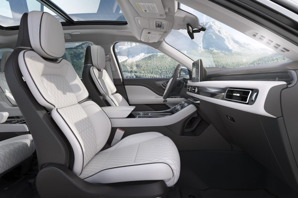 The white and gray leather interior of a 2020 Lincoln Aviator Black Label Chalet edition