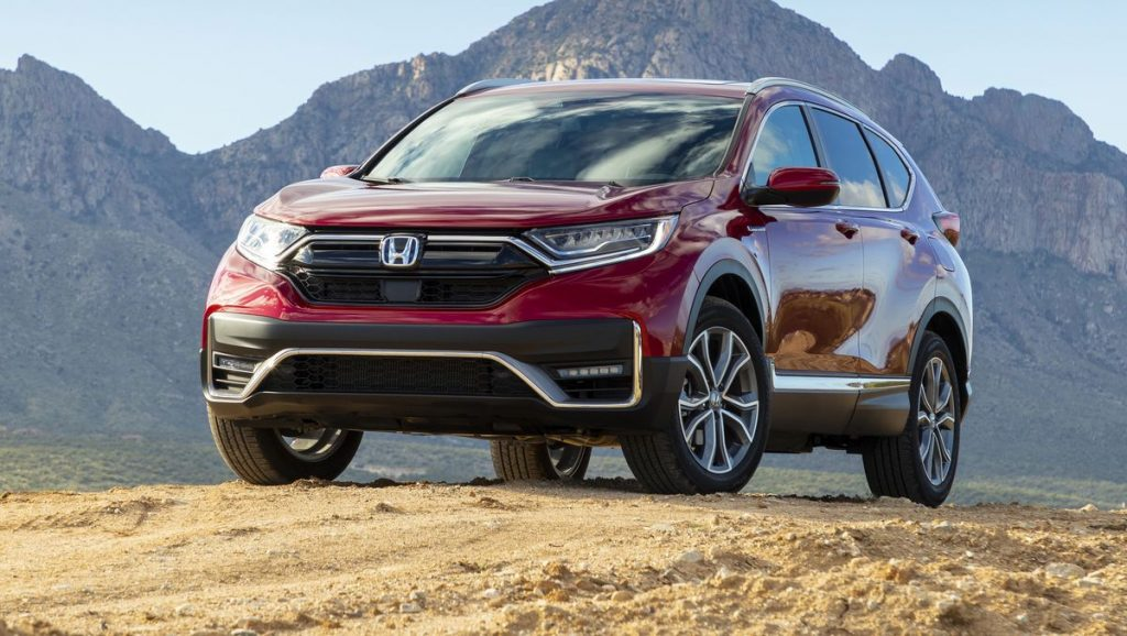 A red 2020 Honda CR-V parked in the dirt near mountains