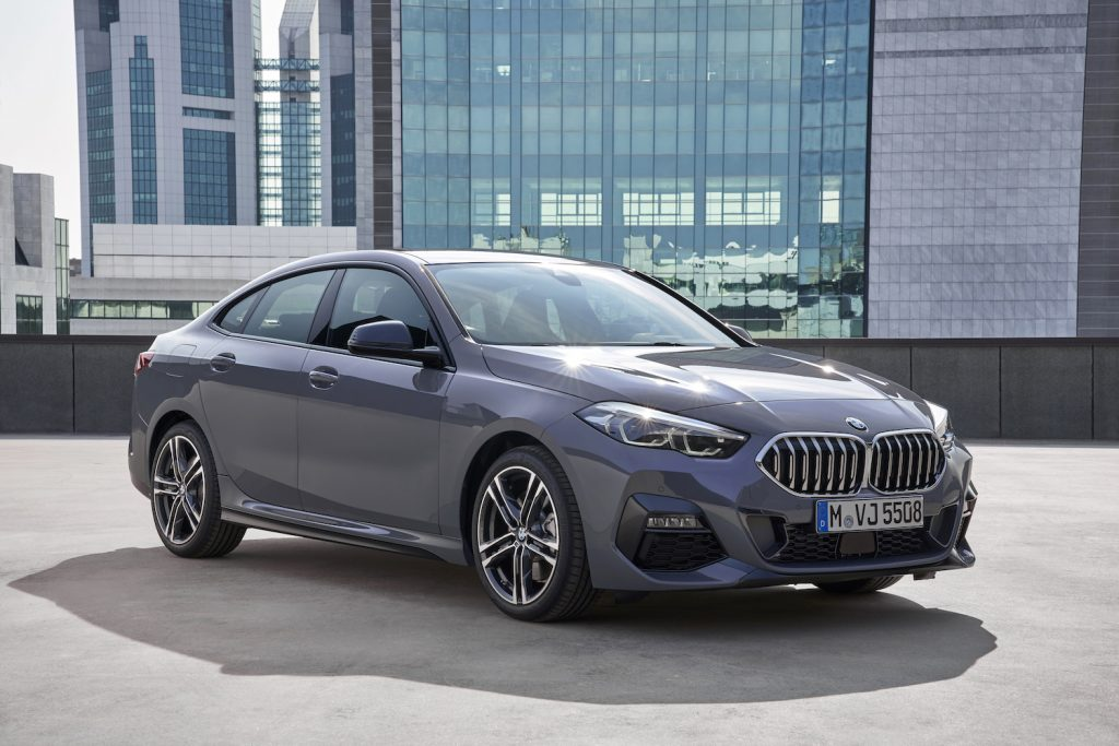 A grey 2021 BMW 2 Series parked in a city