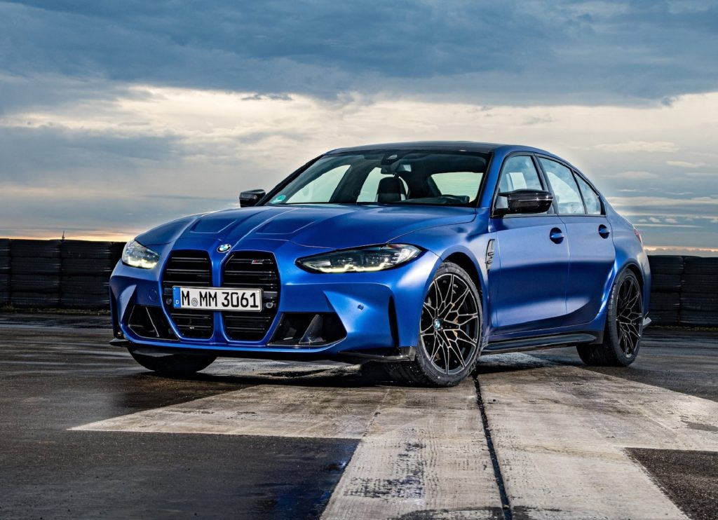 A blue 2021 BMW M3 Competition on a runway