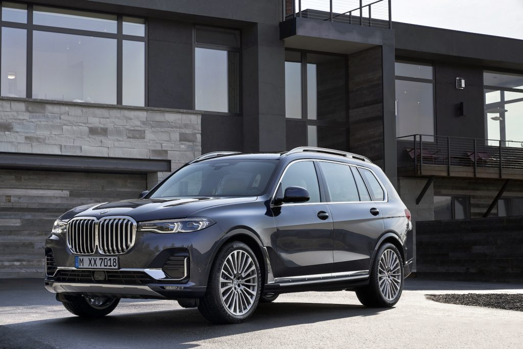 A 2021 BMW X7 parked in front of a house, the 2021 BMW X7 is a large luxury SUV
