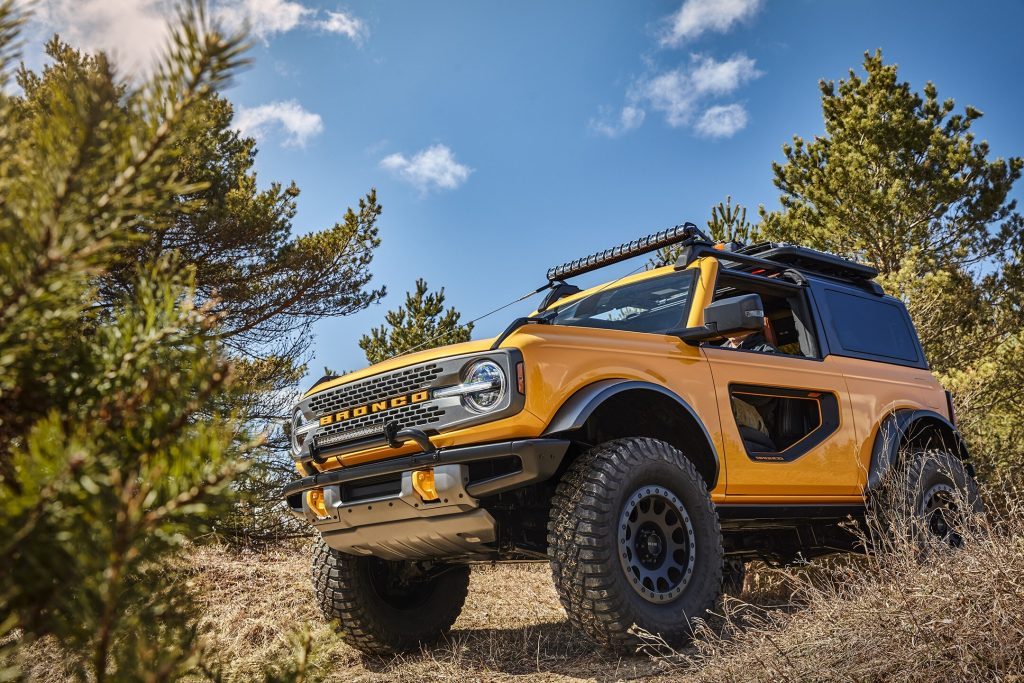 A yellow 2021 Ford Bronco SUV under a blue sky